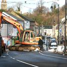 Garda inspects the digger which was used to rip out the ATM during a robbery at the Bank of Ireland on Main St Ballybay. Picture Credit:Frank McGrath