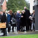 The funeral of William McKee, the founding chief executive of the Belfast Trust