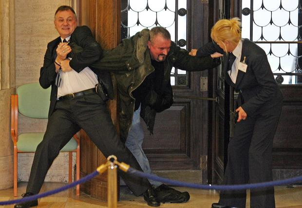 Michael Stone is restrained be security staff at Parliament Buildings (PA)