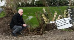 Declan Crumley at the field where water overflows from a drainage pipe