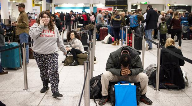 Passengers wait for announcements at Gatwick yesterday