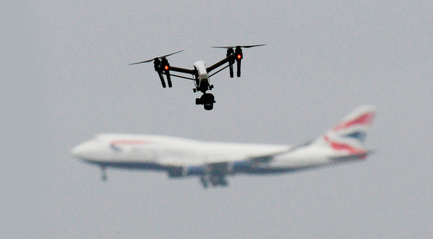 A staged photo of a drone and an aircraft