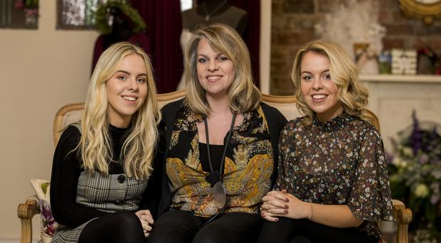 Catherine Smith with her twin daughters Hope (right) and Katie (Liam McBurney/PA)