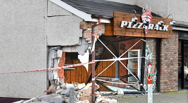 The Pizzarack fast food outlet in Coalisland was badly damaged when a car hit the front of the building