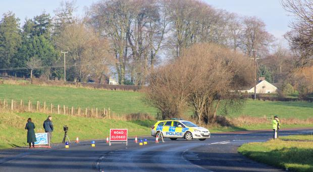 Police at the scene of the fatal accident, which happened on the Moy Road, Co Armagh