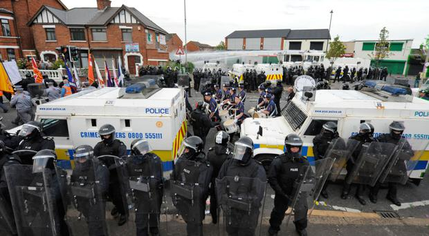 Riot police policing a parade in Northern Ireland.