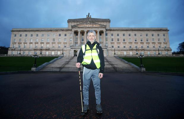 Dylan Quinn outside Parliament Buildings at Stormont after his 90-mile protest walk from Enniskillen ended yesterday afternoon