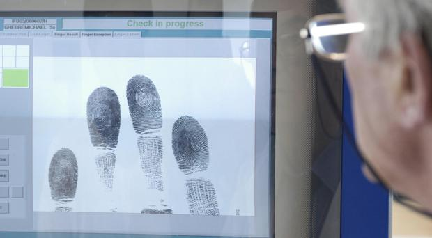 Police have agreed to provide greater public clarity around their retention of DNA and fingerprint data in Northern Ireland (PA)