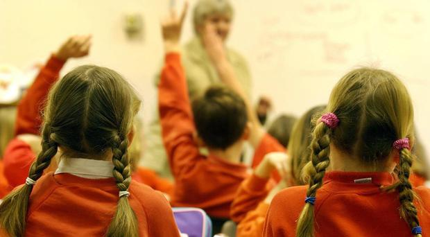 Teachers' unions have urged a major review of the education system in Northern Ireland (PA)