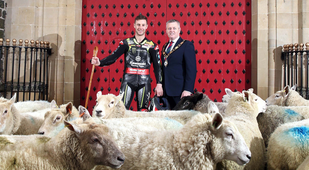 Jonathan Rea with mayor Paul Michael and a flock of sheep at the Barbican gate in Antrim town centre