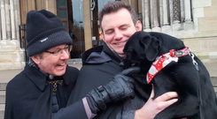 Rev Ian Mills and his dog Xena joined Dean Stephen Forde on the steps of Belfast Cathedral for the Black Santa Sit-out