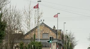Parachute Regiment flags fly from lampposts in Newbuildings