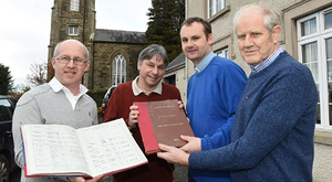From left: Simon Bullock, church warden; Paul Cooke from Co Kildare, the Rev Alastair Donaldson and Charlie Suphlis, church warden, with the recovered church records