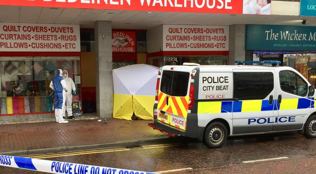 The man was found dead in a shop front on High Street (David Young/PA)