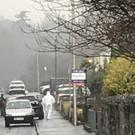 Forensic officers attend the scene of a shooting at a house in Lower Dromore Road in Warrenpoint (Rebecca Black/PA)
