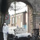 Forensic investigators at the scene of a car bomb blast on Bishop Street in Londonderry.