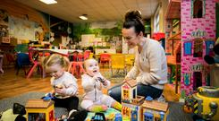 Claire Magill plays with her daughters Thea (left) and Avery play at the childcare group