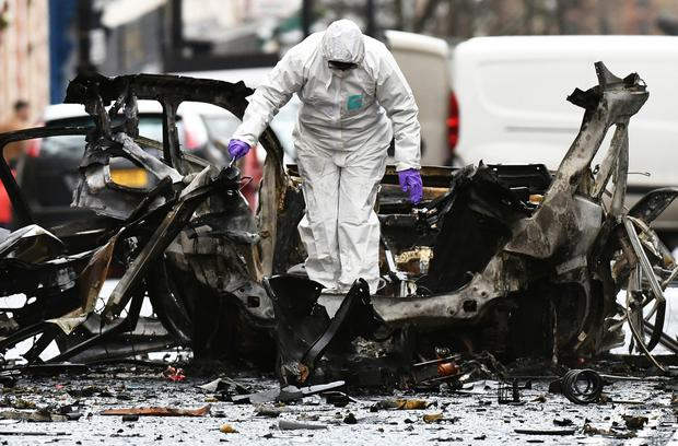 Forensics officers at the scene of the bomb attack outside Derry Courthouse
