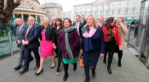 Sinn Fein Leaders Mary Lou McDonald (centre) and Michelle O'Neill (centre right) and their party colleagues leaving Leinster House
