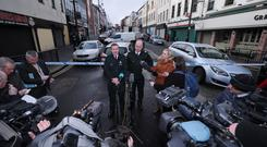 PSNI Superintendent Gordon McCalmont (centre left) and Assistant Chief Constable Mark Hamilton speak to the media near the scene of a car bomb blast on Bishop Street in Londonderry.