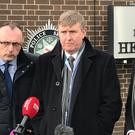 PSNI Superintendent Gordon McCalmont (centre left) and Assistant Chief Constable Mark Hamilton speak to the media near the scene of a car bomb blast (Niall Carson/PA)