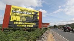 Anti Brexit billboards on the northern side of the border between Newry in Northern Ireland and Dundalk in the Republic of Ireland (Niall Carson/PA)