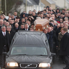 Friends and family carry the coffin of Ian Patterson