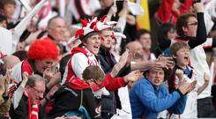 Ulster supporters cheer on their team at the Aviva