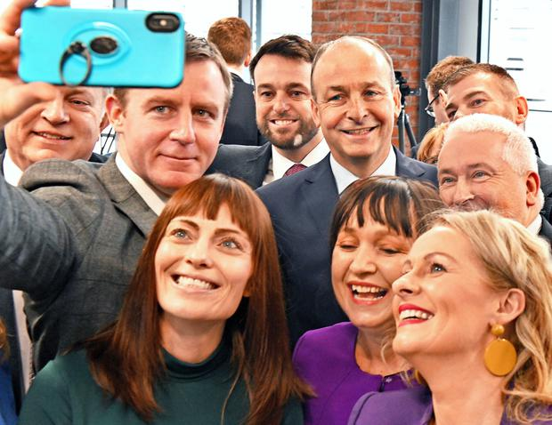 SDLP leader Colum Eastwood, Fianna Fail leader Micheal Martin and colleagues from both parties pose for selfie