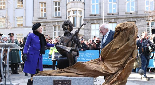 Michael D. Higgins and his wife Sabina Coyne unveil a statue of Luke Kelly in King Street South in Dublin, one of two being unveiled for the founder member of The Dubliners.