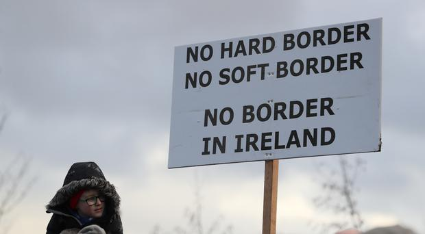 People take part in an anti-Brexit rally at the Irish border (Brian Lawless/PA)