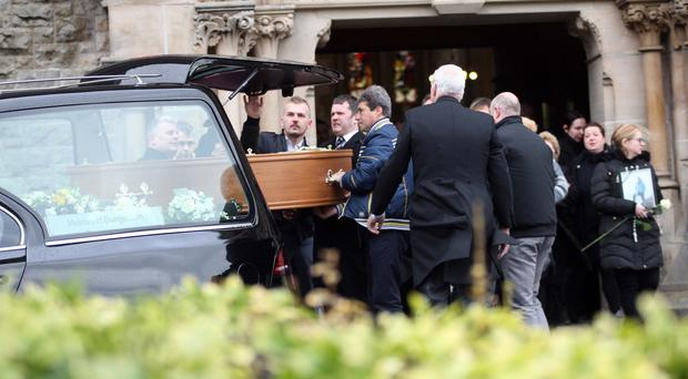 Mourners at the funeral of Alaedin Fejzula in Dungannon yesterday