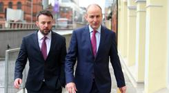 SDLP leader Colum Eastwood and (right) Micheal Martin, leader of Fianna Fail, arriving for a joint press conference in Belfast last month