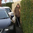 Gerald Totton struggles with a van and bins on the pavement