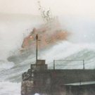 Some 30 years ago today the volunteer crew of Portrush Lifeboat launched in dreadful conditions to reports of two Spanish trawlers in difficulty. This was when the famous Portrush picture was taken by photographer Ian Watson