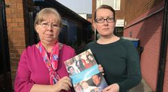 Marian Walsh, mother of UFF murder victim Damien Walsh, left, with Relatives For Justice case worker Mary McCallan (Rebecca Black/PA)