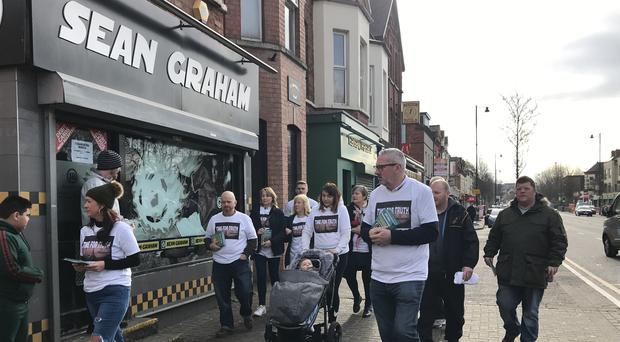 People involved in the Time for Truth campaign, on Saturday outside the Sean Graham bookmaker's on Ormeau Road in Belfast, collected signatures for a petition to implement mechanisms to deal with Northern Ireland's troubled past (Rebecca Black/PA)