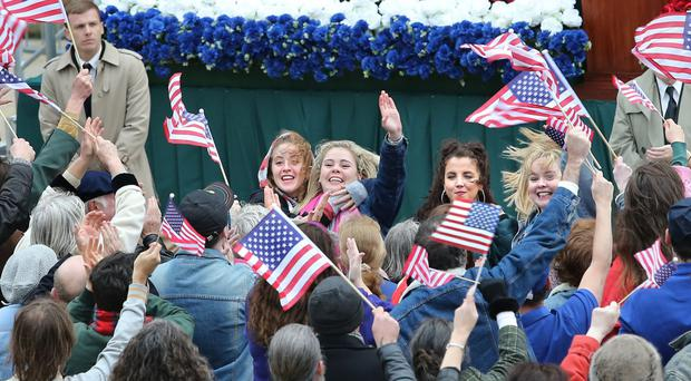 The stars of Derry Girls on set in the city, where they filmed scenes centred on US President Bill Clinton's visit in 1995