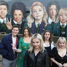 Derry Girls creator Lisa McGee (second from left) with cast members visiting the Derry mural by UV Artists
