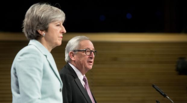 Theresa May and European Commission president Jean-Claude Juncker (Etienne Ansotte/EU/PA)