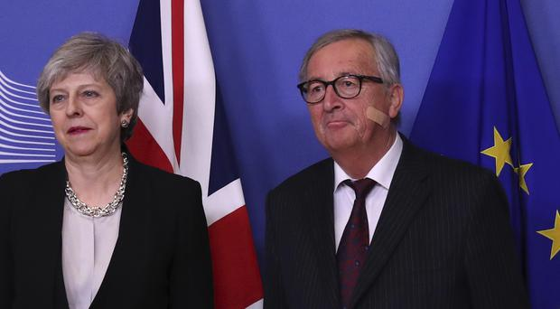 Theresa May is greeted by Jean-Claude Juncker (Francisco Seco/AP/PA)