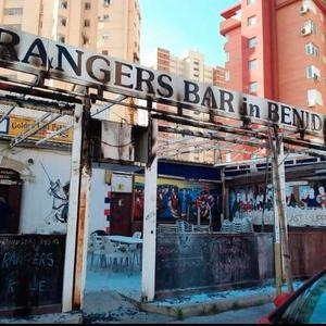 Rangers banners outside The Golden Last pub in Benidorm were set alight yesterday morning