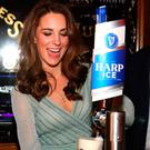 The Duchess of Cambridge pulls a pint during her visit to Belfast's Empire Music Hall yesterday