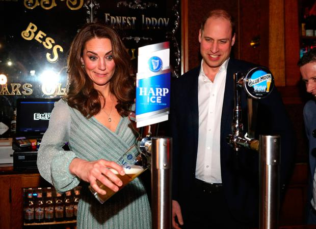 The Duchess of Cambridge pulls a pint during her visit to Belfast's Empire Music Hall