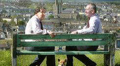 SDLP's John Hume and Mark Durkan take a break in Derry in 2005