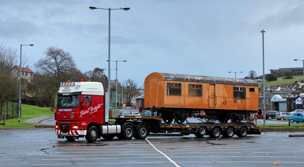 The railway carriage being moved by lorry