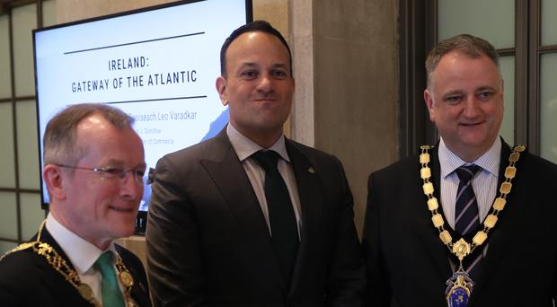 Leo Varadkar (centre) with President of the Dublin Chamber of Commerce Niall Gibbons (left) and John Healey, President of the Northern Ireland Chamber of Commerce, at the US Chamber of Commerce in Washington DC (Brian Lawless/PA)