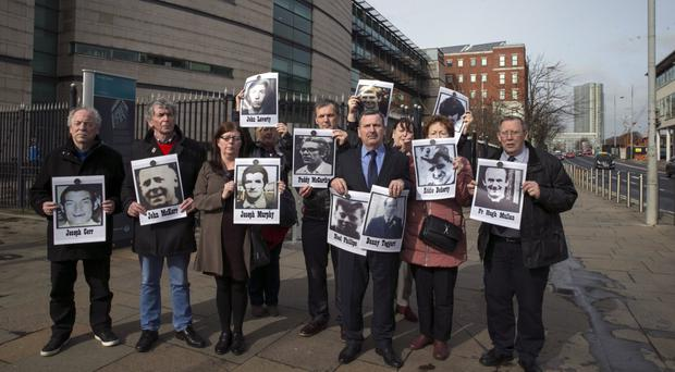 The families outside court yesteday as the Ballymurphy inquests continue