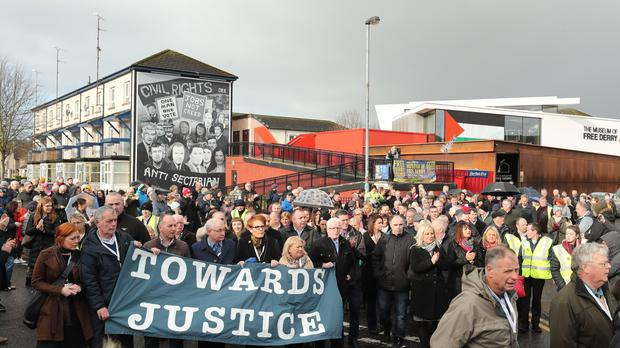 The Bloody Sunday families carried a banner reading 'towards justice' as they marched to Londonderry's Guildhall on Thursday (Niall Carson/PA)