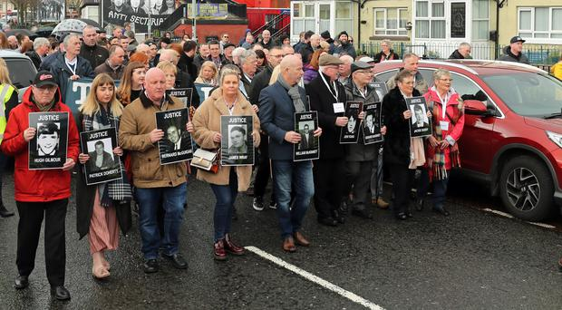 Families of those died march through the Bogside in Londonderry (Niall Carson/PA)
